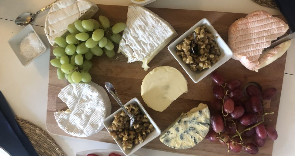 Pictured are gluten-free cheeses and fruits