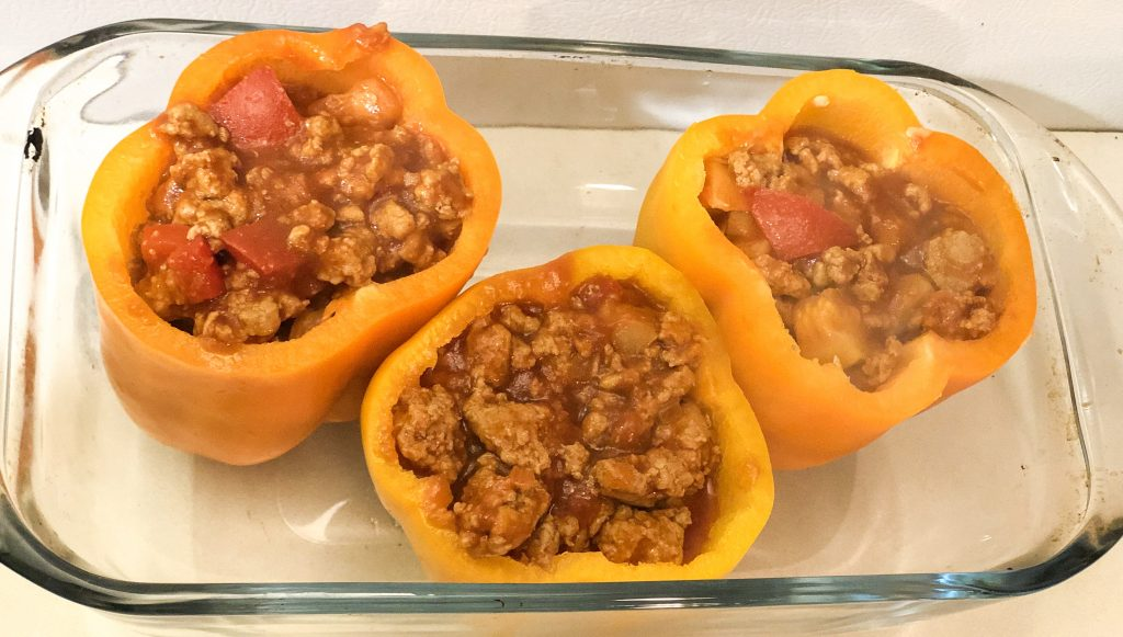 stuffed orange and yellow bell peppers